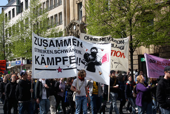 A number of large banners, including one asking for a revolution and one saying &ldquot;Zusammen Streiken. Schwänzen. Kämpfen!&rdquot; (Together Strike. Skip. Fight!
